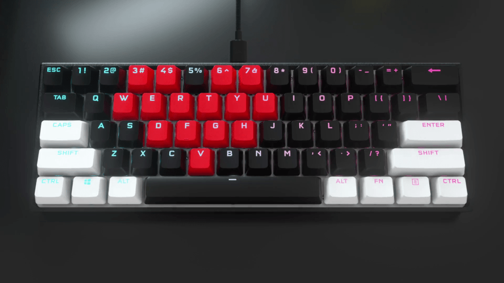 K65 RGB MINI mechanical gaming keyboard with different color PBT DOUBLE-SHOT PRO Keycap Mod kits installed to make a heart-shaped design.